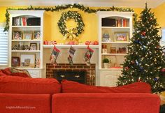 Draping the Biltmore Pine Garland over the bookcases maintains the cheery ambiance of the living room.