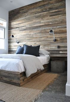 reclaimed wood wall. bedroom. wall sconces. modern rustic.