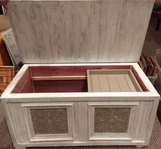 Hope Chest made from reclaimed wood, cedar lined inside, and antique tile tins as décor for the front.