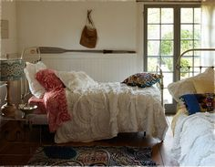 This bedroom is perfect for a vacation house. Sleeps lots of people and very casual.