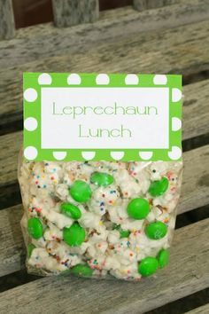 Leprechaun Lunch  Pop popcorn and melt white chocolate. Spread the popcorn on a cookie sheet, clean unwanted kernals.  Pour the melted chocolate over the popcorn & mix well.Sprinkle w/rainbow sprinkles- Once you do this do not mix the popcorn otherwise you will coat the sprinkles and they won't be rainbow anymore. Once the mix has set (this may take an hour or longer) add in your M's. Serve in a big bowl or make into individual snacks. For the individual snacks, I only used the green M'