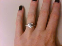 Her center stone is 2.01 carats, 16 diamonds on band (.41 carats) and Size 5.25.    Found on Weddingbee.com Share your inspiration today!