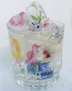 Floral Ice Cubes..SO pretty! ( freeze edible flowers!) Boil your water first for crystal clear ICE!