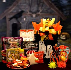 """Halloween Boo Activity Bag $49.99 Send all the ghouls and goblins in your clan this fun filled activity and treats gift bag. This fun fabric bag carries games, toys treats and more. Great for tweens and the """"Big Kids"""" This fun activity bag includes: Candy Flavored bubbles,Hand Held Brain Twister game,Relaxable smiley face ball,Squishy fun ball,Silly Putty, microwave popcorn,pretzels, and assorted candy favorites!"""