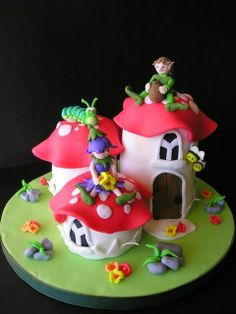 Toadstools - Here's my take on Debbie Brown's Toadstools ... I added a flower fairy and a caterpillar ... cute! All made of fondant!