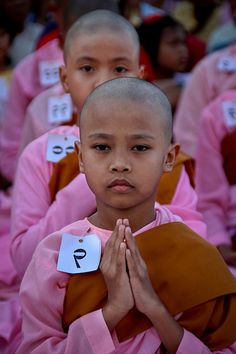 Young nuns praying . Shwedagon pagoda. Yangon, Myanmar