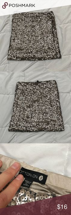 COTTON ON Sequin NYE Bodycon Sparkle Skirt Condition: EUC, hardly worn Color: taupe, gold/grey Fit: true to size, has a good amount of stretch, hugs the hips very nicely, super flattering! Fabric: outer (not including sequins): 100% polyamide, inner (pictured, sequins on bottom inch on the inside): 100% polyester Measurements: waist: 26 in (worn right below the belly button), length: 15.5 in Personality: This skirt is so much fun and is perfect for a New Year's or Christmas party! Cotton On…