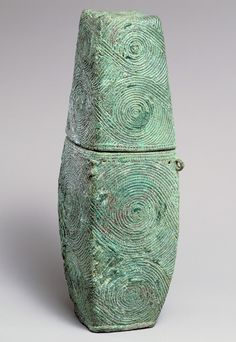 Container with spiral decoration, Bronze and Iron Age, Late period, 300 B.C.–200 A.D. Thailand. The large flowing spirals covering the surface of this elegant container are among the most prevalent of the geometric motifs that decorate bronze ritual and luxury objects produced in many regions of present-day Thailand from the fourth century B.C. to the third century A.D.