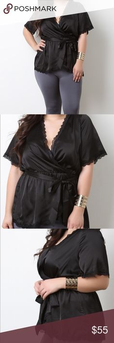 Satin self tie top in black This plus size top features smooth satin fabrication, delicate lace trim, surplice front, short sleeves, elasticized waist, and self-tie sash. Accessories sold separately. 100% Polyester.  SHIPPING in approx. 5-7 days Tops Blouses