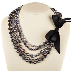 Multi strand necklace (pearls, crystals, etc) with HUGE black ribbon bow!