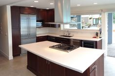 Cherry cabinets and kitchen island with white counter