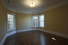 MATERIALS/ FLOOR: Hardwood floors/ WALLS: Smooth wall / LIGHTS: Pendent light in the middle on the room provides all the needed light/ CEILING: Smooth ceiling/ TRIM: Base board trim, trim around windows and doors, as well as crown molding/