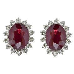 Ravishing ruby earrings in 18K white gold with 8.88ct center stones and 1.64ct premium cut round Diamonds.