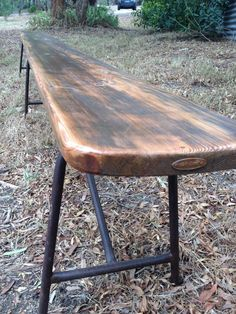 Long bench seat – vintage rusted tubular steel frame coated to seal and protect from further rusting. Reclaimed oregon timber seat, that had a past life as an RSL fascia board.