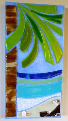 Calm Palm Island fused glass on canvas. Add a new texture, gloss, and style to your wall with this freshly fired and painted piece. Calm tropical palm with beautiful beach scene, crashing sparkly colorful waves, white sandy beach, and hot black lava rocks. (Big Island shells add a
