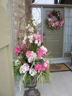 Great idea for a spring, a pink floral arrangement in a lovely urn with matching wreath for your front door.  Custom designed by Doris at Grand Entrance Design in Bolton/Caledon.  www.grandentrancedesign.com