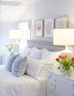 Clean and white colour scheme with some calming blue and pops of colour  from the flowers.
