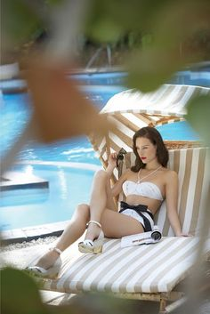 Bond girls do not sweat....looking fabulous and lovely by the pool...