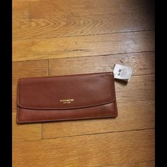 Authentic Leather Coach wallet This beautiful brown slim wallet will look nice coming out of any hand bag. Great slim fit and holds all the essentials Coach Bags Wallets