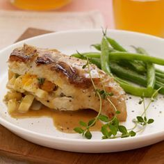 Apple-Stuffed Chicken -- Apple cider and fresh apples team up to infuse chicken with plenty of sweet flavor while keeping it juicy and moist. #myplate #fruit #protein