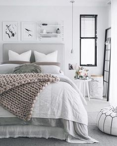 Grey is the new white! Love the way this color is paired with serene tones for a calming bedroom decor.