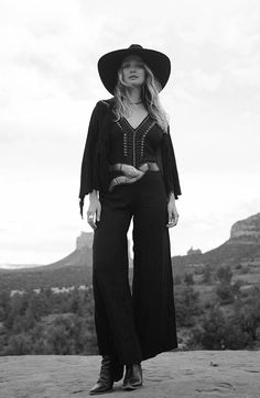 Co-designed by musician Zella Day, the Josey Wales Jumpsuit is inspired by 70's goddesses and the southwestern influence of Zella Day's Arizona roots. The vintage inspired wide leg cut is offset by em