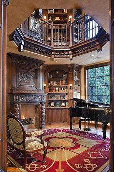 Music room--but look at the scroll work on the fireplace and the banisters, the red and cream color carpet, the amazing second floor view, wood flooring, large window for lots of music reading light.. and so much more!