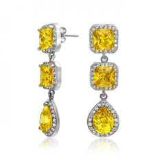 These princess cut cubic zirconia earrings are the epitome of high fashion. The unique and elegant design of these dangle drop chandelier earrings features two princess cut, cubic zirconia stones, and a solitaire tear drop sh Jewelry Party, Bling Jewelry, Costume Jewelry, Bridal Earrings, Women's Earrings, Cheap Jewelry Online, Expensive Jewelry, Birthstone Jewelry, Mellow Yellow