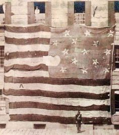 The Flag that is the Star Spangled Banner.  This flag flew over Fort McHenry September 12-13, 1814 during the British bombardment.  It is 30 x 42 feet!! and was made by Mary Pickersgill of Baltimore at a cost of Four Hundred Five dollars and Ninety cents.  It was donated (in tatters) to the Smithsonian in 1912 and was reinforced with a linen backing and 1.7 million stitches.