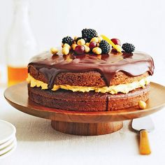 Chocolate Harvest Cake- The aromatic autumn flavors of cinnamon and pumpkin in the creamy filling partner flawlessly with the chocolate layers in this beautiful cake