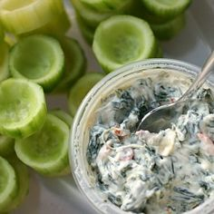 Cucumber cups filled with creamy spinach dip make an excellent summer appetizer!
