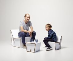 Family sit on kenno chairs that made of cardboard recycled