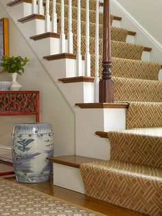 Stair Runner - A geometric-pattern stair runner boosts both the comfort and style of this staircase. In addition to providing softness and warmth underfoot, the runner also prevents walkers from slipping on the potentially slick wooden treads.