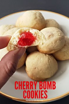 Cherry bomb cookies are...the bomb! I love how this soft and chewy cookie has a fun cherry center. They're cute, and everyone loves the surprise inside. This is a perfect Christmas cookie for a cookie exchange. This is a simple homemade cookie recipe, an you don't need to roll it out or refrigerate the dough before you bake them - winning! Homemade Desserts, Easy Desserts, Dessert Recipes, Christmas Recipes, Holiday Recipes, Christmas Ideas, Delicious Cookie Recipes, Best Cookie Recipes, Best Sugar Cookies