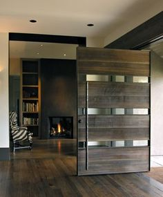 Glass & sandblasted Douglas Fir front door. Awesome! I'd probably use frosted glass instead of clear. Modern Entrance, Modern Door, Entrance Doors, Modern Exterior, Front Doors, Barn Doors, Pivot Doors, Front Door Design, Exterior Doors