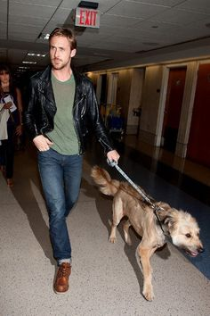 Shop Ryan Gosling's look for $188:  http://lookastic.com/men/looks/black-leather-jacket-and-olive-crew-neck-t-shirt-and-navy-jeans-and-walnut-boots/1269  — Black Leather Jacket  — Olive Crew-neck T-shirt  — Navy Jeans  — Walnut Leather Boots