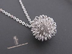 Hey, I found this really awesome Etsy listing at http://www.etsy.com/listing/92705145/sale-10-off-dandelion-necklace-in-white