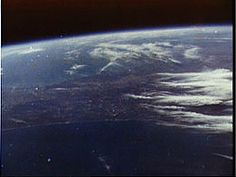 Photo taken by John Glenn during first manned orbit. Our beautiful planet Earth, may we always be in awe.