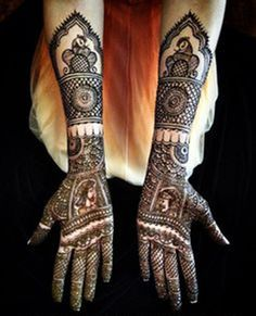 Bridal Mehndi on hands and arms with faces.