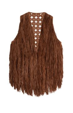 With supple fringing on the front and soft leather at the back, this Emilio Pucci vest is a statement piece with longevity. Colored in a deep shade of tan with metallic gold eyelets, the snug fit means it's perfect over airy tunics or with leather leggings #Stylebop