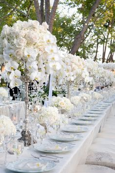 Although I like this only white table...hmmm....Tall Candelabras w/ white flowers-Bling