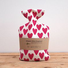 This gorgeous red lovehearts print wheatabottle warmer is a perfectly sized holistic thermos-therapy remedy for aches, pains or injuries, or just to use for a cosy cuddle when you need extra warmth. Designed, printed and lovingly sewn together by independent designer Megan Alice England at her Gloucestershire studio, it's unique and special! Because the wheatabottle warmers can be heated quickly in the microwave, they're quick and convenient to use. #valentines #heart #love