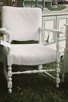 Love this chair recovered in an old bedspread!
