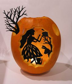 Just cut somewhat decorative holes in an empty pumpkin and put black, cutout silhouettes of your favorite fairy tale (the creepier the better!) inside. Light a candle behind the silhouette