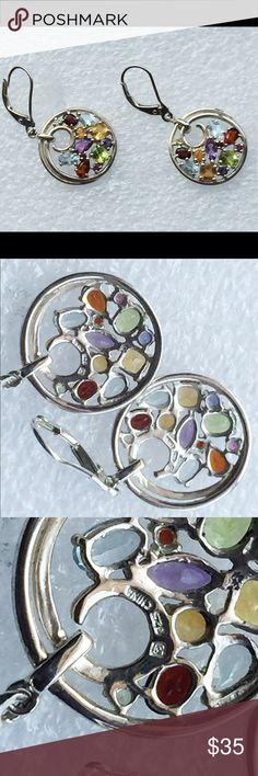 """Designer Signed Multi-gemstone Sterling Earrings Very nice designer signed sterling silver and multi-gemstone earrings (We have a  pendant to match perfectly; sold separately) - A nice round bamboo style pendant with amethyst, garnet, blue and gold topaz, peridot and clear gemstones - Approximately 1-1/2"""" - This came from a recent estate - Hallmarked with a makers mark 925 China Jewelry Earrings"""