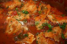 Cajun Courtbouillon - a roux-based fish stew, made with creole tomato sauce, stewed down and reduced, and used to poach fish - often redfish, red snapper or catfish.