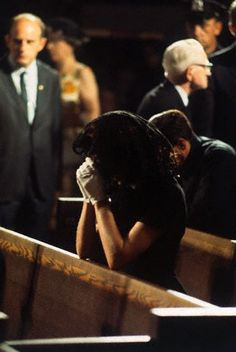 Jackie prays at St. Patrick's Cathedral in New York City, as Bobby's body lies in state, June 7, 1968,