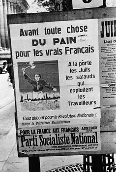 """by David Seymour - FRANCE. Paris. Anti-semitic campaign poster of the National Socialist Party says """"Above all, bread for the real Frenchmen"""" // Magnum Photos"""