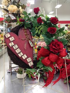 Valentine wreath from Michael's Store best I can tell.  Nice job to the people who made it.  Kept pin for inspiration only.