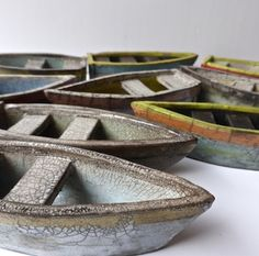 Rowboat is my range of smaller pieces. Each piece is individually handmade and raku fired by me. The range includes raku fired houses, rowboats, floats which are cast from fishing floats I've found on the beach and roofless houses inspired by the abandoned homes on the islands of St Kilda.